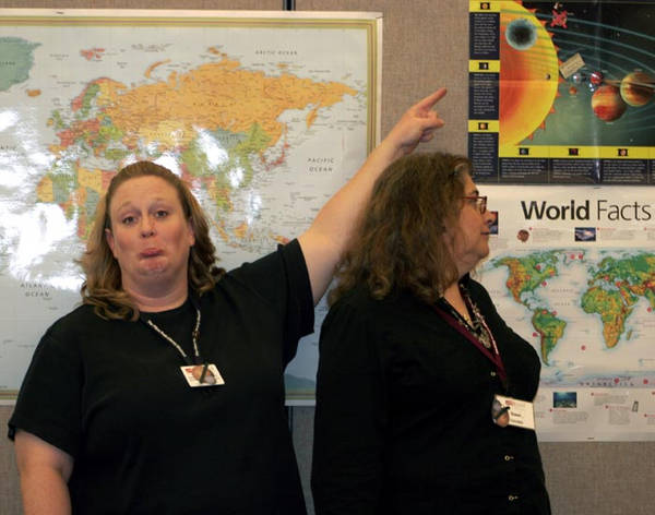 Michelle (with Abby's mom) pointing at our dear departed planet.
