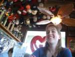 Inside the Sea Shanty. (The owner collects hats.)