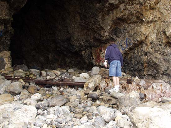Taso going into the cave